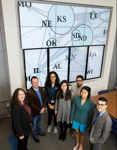 From left to right: Karen Garrett, John Hernandez Nopsa, Jeanelle Brisbane, Yanru Xing, Ravin Poudel, Si Lin Lei, Bryan Cordova
